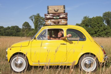 Couple in old-fashioned car on road trip