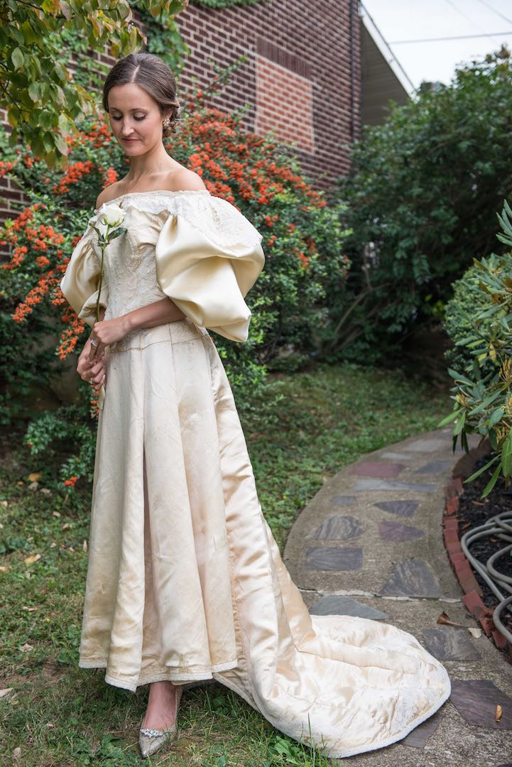 Abigail Kingston tries on a wedding dress, Sept. 22, 2015 that has been passed down in her family for over 100 years and will be the 11th bride to wear it. Easton-area designer Deborah Lopresti put in 200 hours to restore the dress.