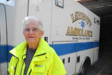 MONTVILLE, Maine -- 7/20/15 -- Edna Mitchell, 87, the oldest emergency medical technician in Maine, stands next to an ambulance on Monday in Montville. She drives for Liberty Ambulance and helps when there are car accidents and other medical emergencies in Liberty and Montville. Abigail Curtis | BDN