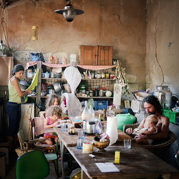 Angela, Angelo and their 3 daughters having breakfast in the kitchen-living room made from an old stall. This is a temporary place before their new huse will be ready.