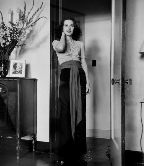 Glamorous full-length portrait of movie actress Hedy Lamarr wearing long gown superimposed (probably unintentionally) over portrait of her.