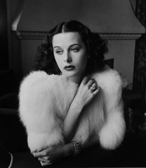 Glamorous portrait of movie actress Hedy Lamarr wearing white fox fur short jacket.